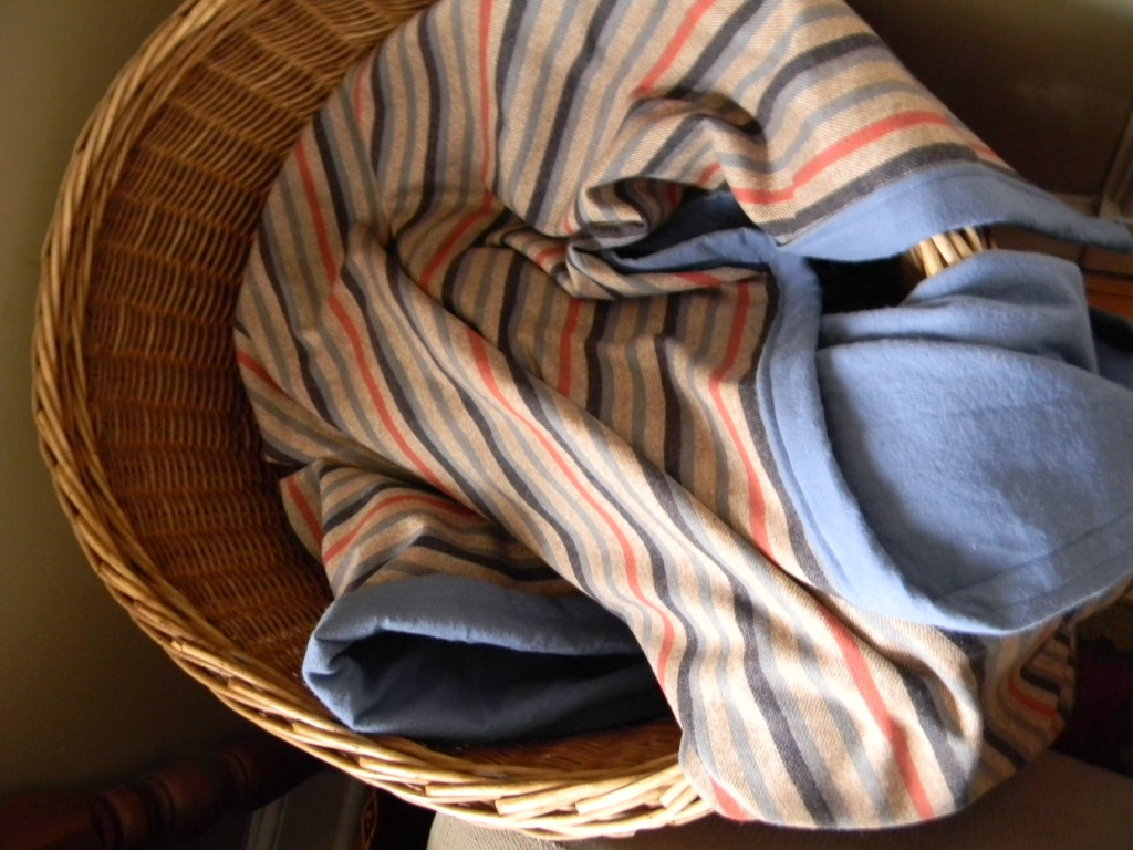 stripy blanket in basket