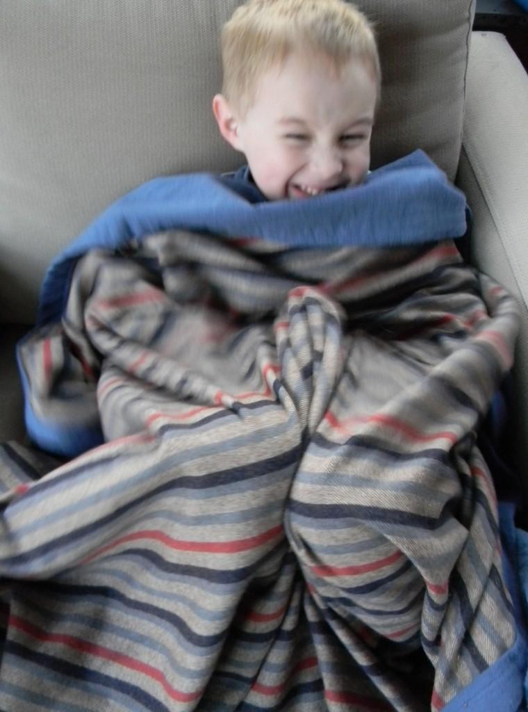 snuggly guy in stripy blanket
