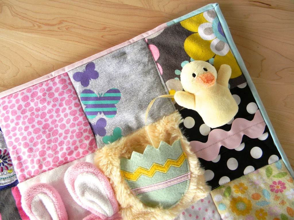 removable duck on baby clothes quilt