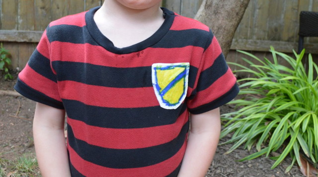 Imaginary world soccer badges on this kid-art t-shirt. | Made by  A Happy Stitch
