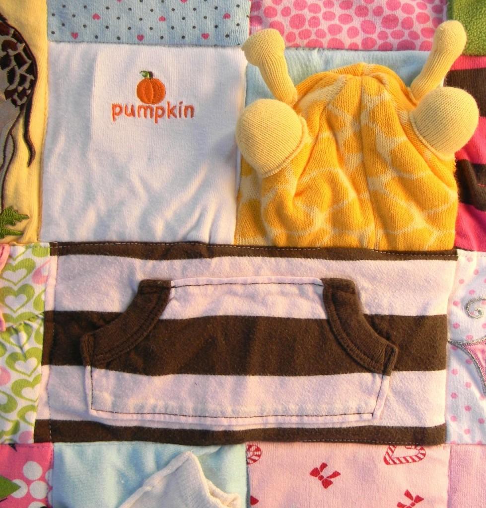 giraffe hat on baby quilt by a happy stitch