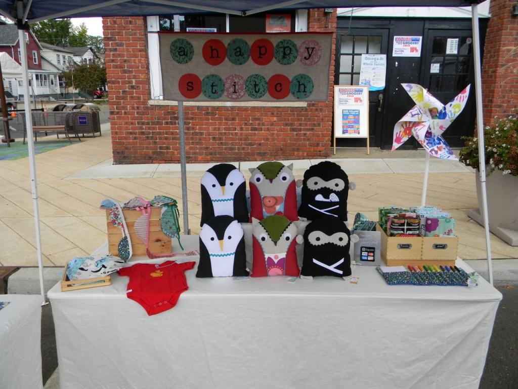 front view of a happy stitch booth